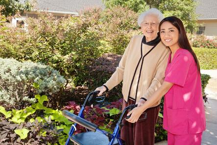 Photo of an elderly woman and her caregiver